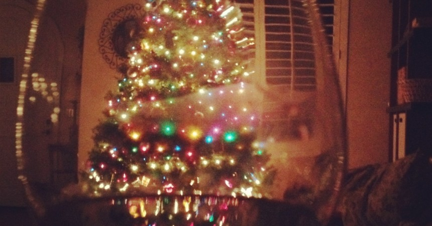 Christmas tree through wine glass