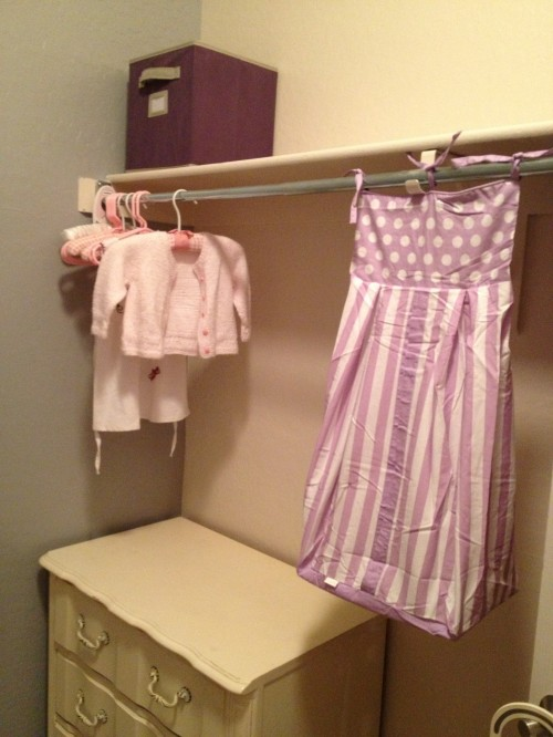 closet nursery, small spaces, diaper stacker